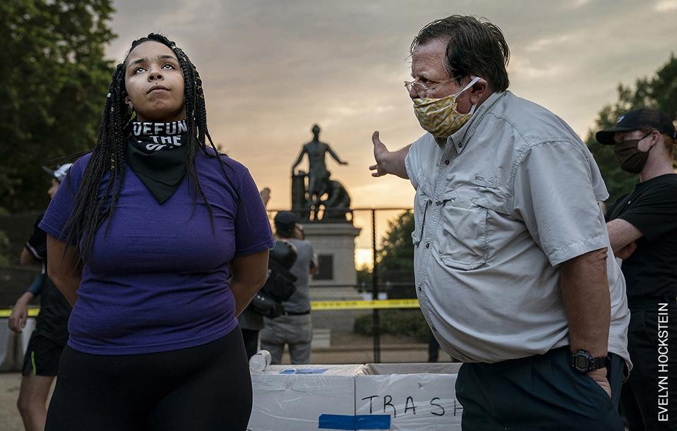 White man and black woman argue over Emancipation Memorial, Washington