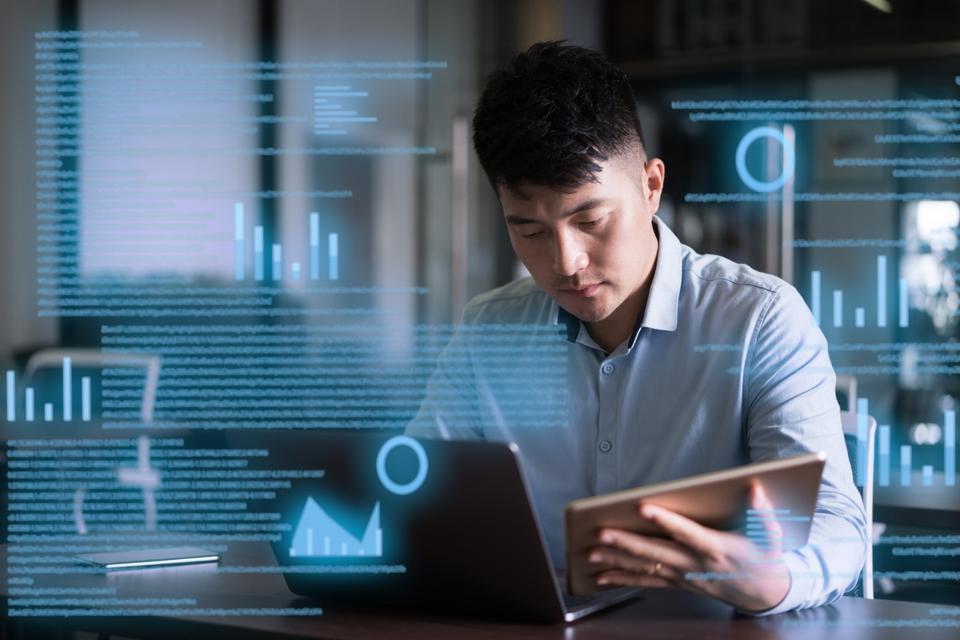 man uses laptop on virtual visual screen