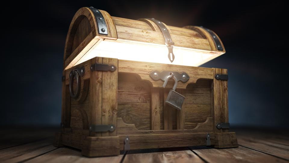 Old wooden treasure chest box with  glow from inside