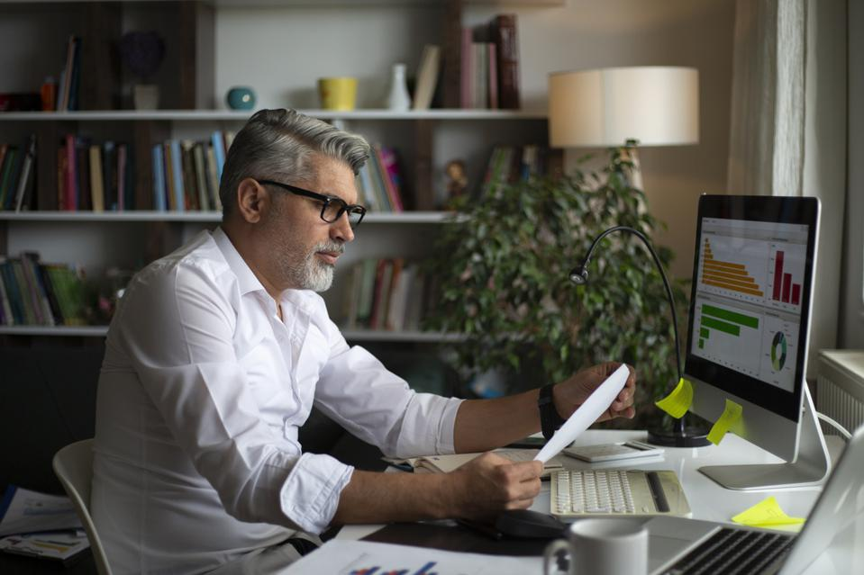 Man using desktop pc at desk in home office