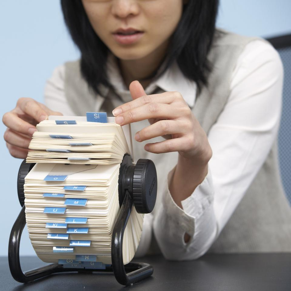 Businesswoman Going Through Rotary Card File