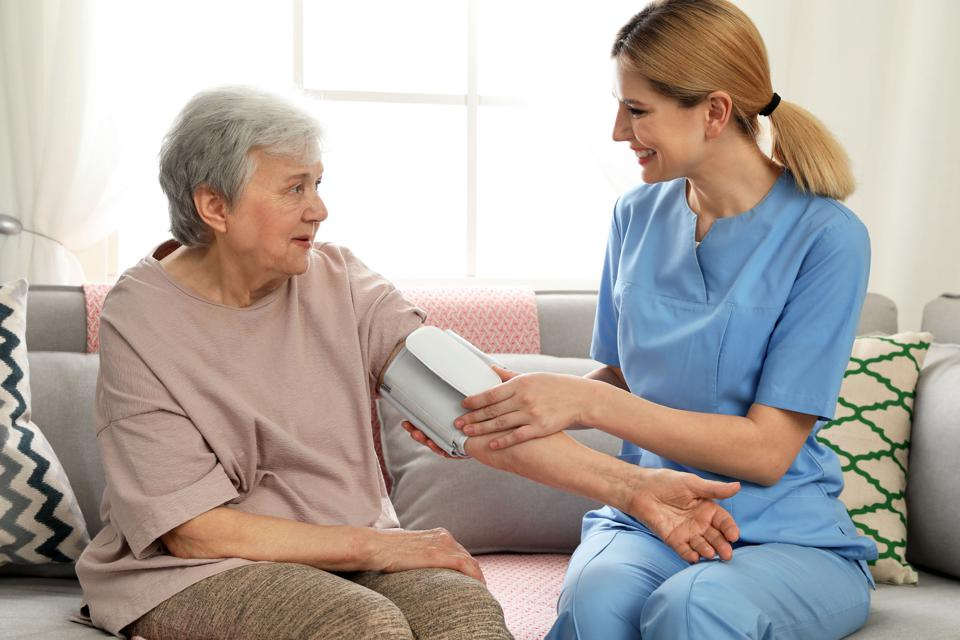 Caregiver attending to an elder