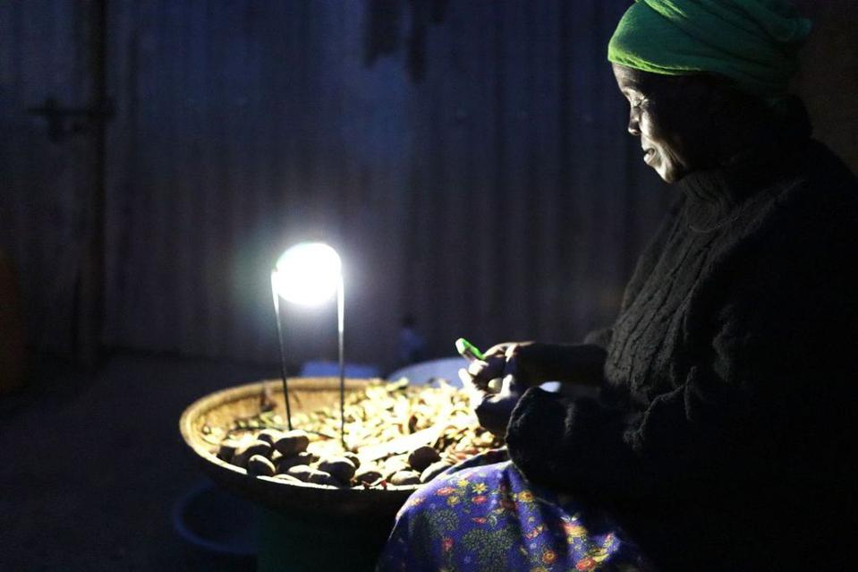 A solar powered lamp enables work to continue after dark.