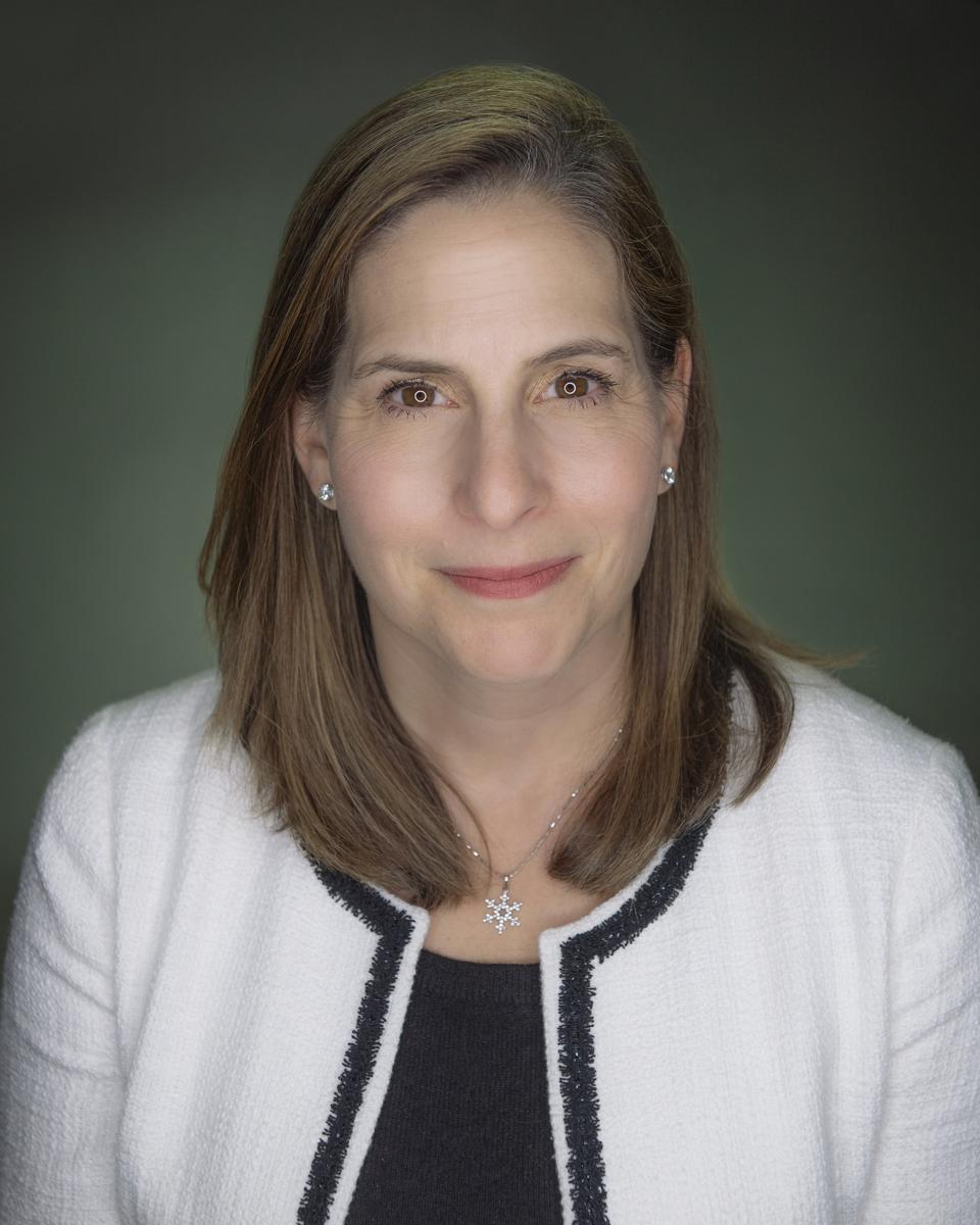 Sheri Thompson, woman with shoulder-length brown hair, smiling at camera