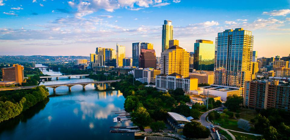Austin texas panoramic panorama aerial drone sunrise golden colors across colorful skyline cityscape