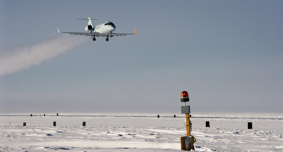 An FAA Bombardier Challenger makes a test-calibration approach to a runway.