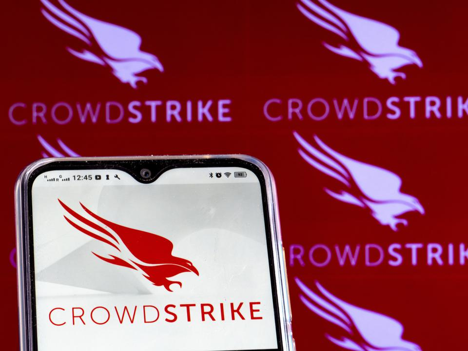 In this photo illustration a CrowdStrike Holdings, Inc. logo...
