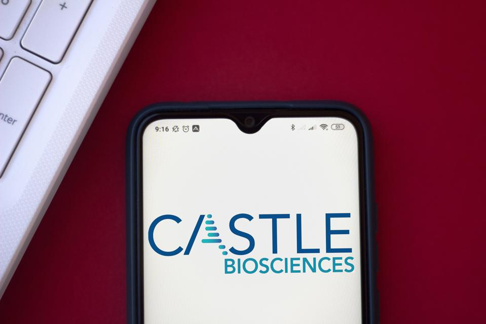 In this photo illustration the Castle Biosciences logo seen...