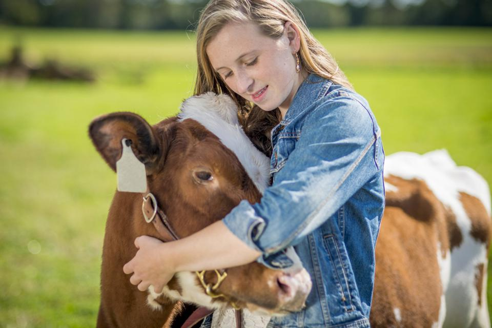 Girl holding her cow