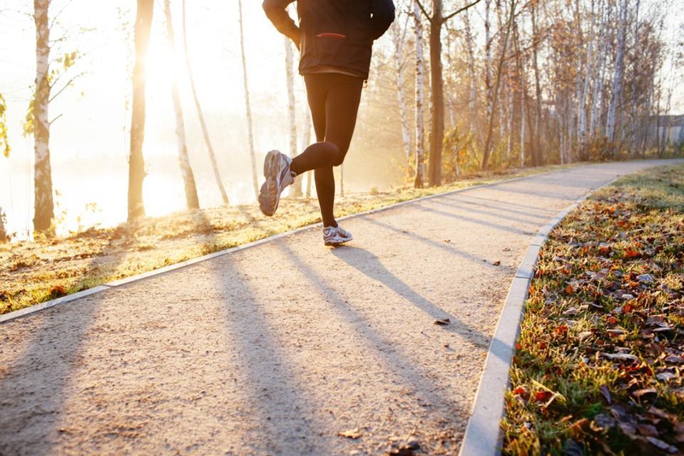 Man running at autumn during sunrise