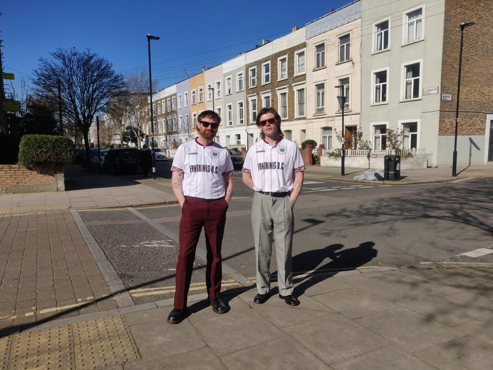 Tom Coll and Conor Curley of band Fontaines D.C. wear Bohemian FC jersey.
