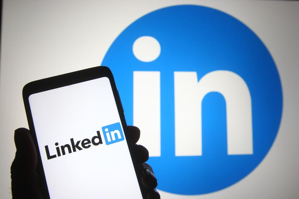 In this photo illustration a LinkedIn logo of business and...