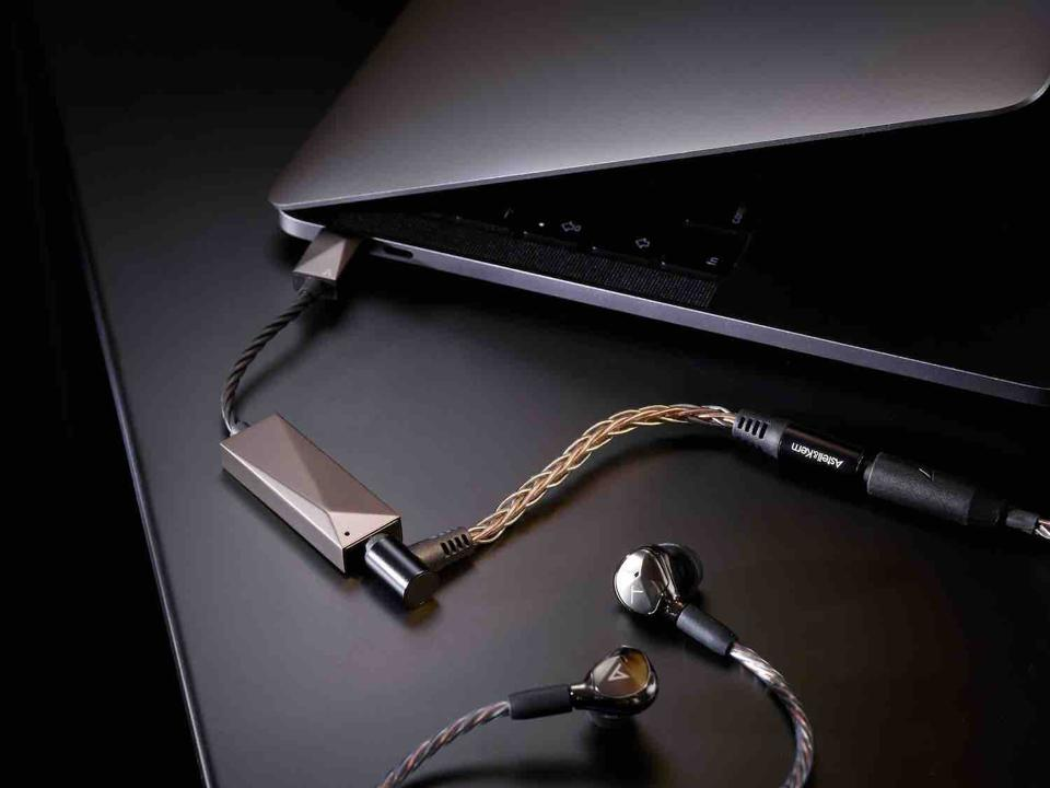 AK USB-C Dual DAC Cable plugged into a laptop and with earphones connected