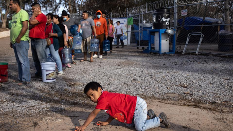 Asylum Seekers Cross Into U.S. In Reversal Of Trump's ″Remain In Mexico″ Policy