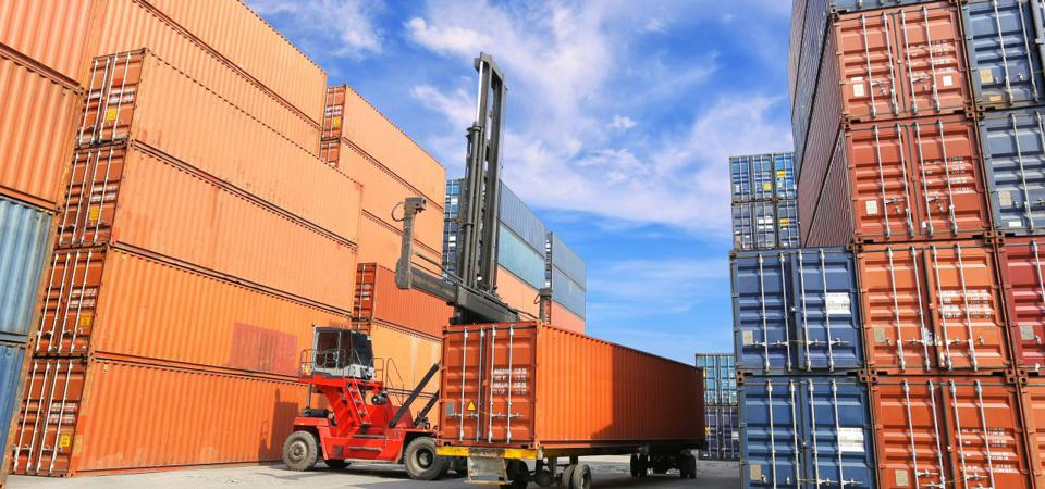 Shipping Containers at a Port being sorted for unpacking and repacking