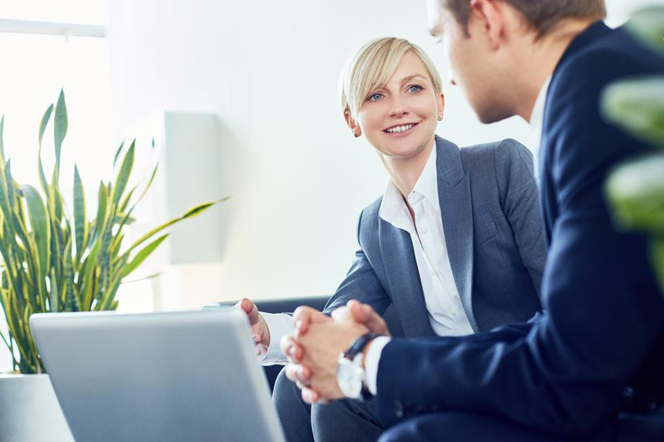 Positive cheerful business consultant working with client