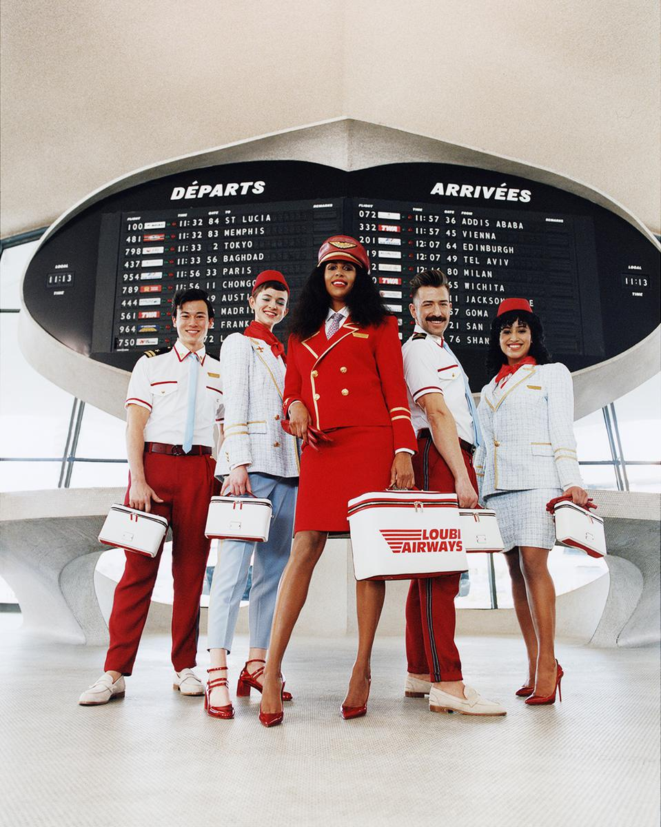 Still shot of models form the Christian Louboutin Autumn Winter 2021-2022 collection film at the TWA terminal at JFK airport.