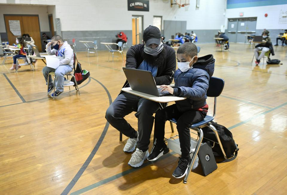 A boy learning remotely in the gym at a Boys And Girls Club In Pennsylvania.