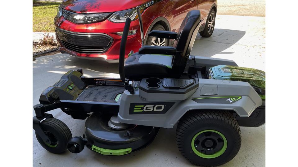 EGO Power+ 42″ Z6 Riding Mower next to Chevy Bolt
