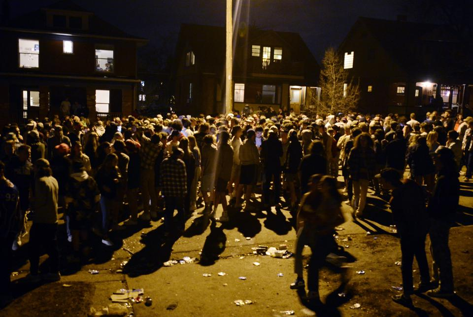 Hundreds of students joined a party in Boulder. A SWAT team used commands, tear gas, and sirens to disperse.