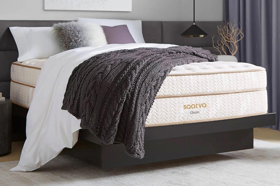 Saatva Classic mattress set up on a bed