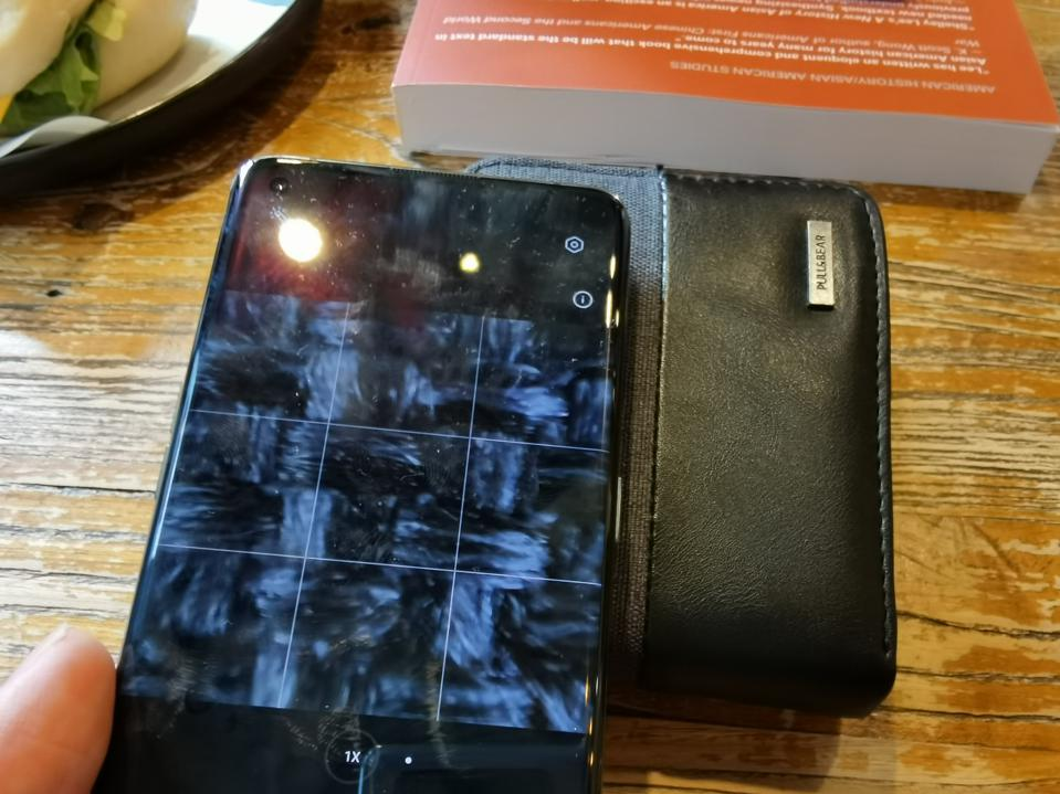 The Find X3 Pro's micro-lens can see the indiviual strands of fiber of my wallet.