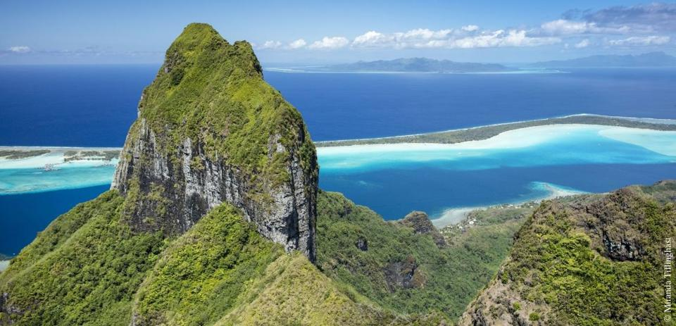 One of the many islands of Tahiti with vegetation growth.