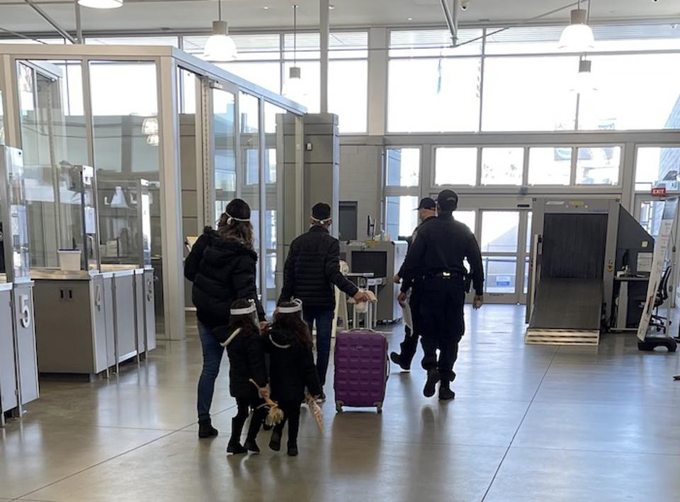 A family previously enrolled in MPP approaches the border, where they will be allowed to continue pursuing their asylum case while in the U.S. with support from the JFSSD immigration services team.