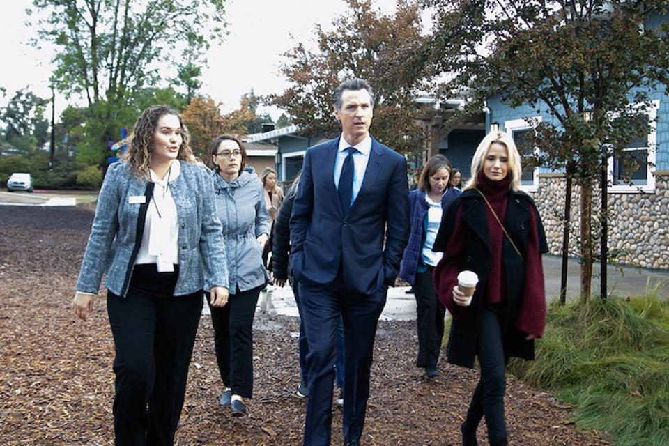 JFSSD's Kate Clark leads a shelter tour for California Governor-Elect Gavin Newsom and staff in November 2018.