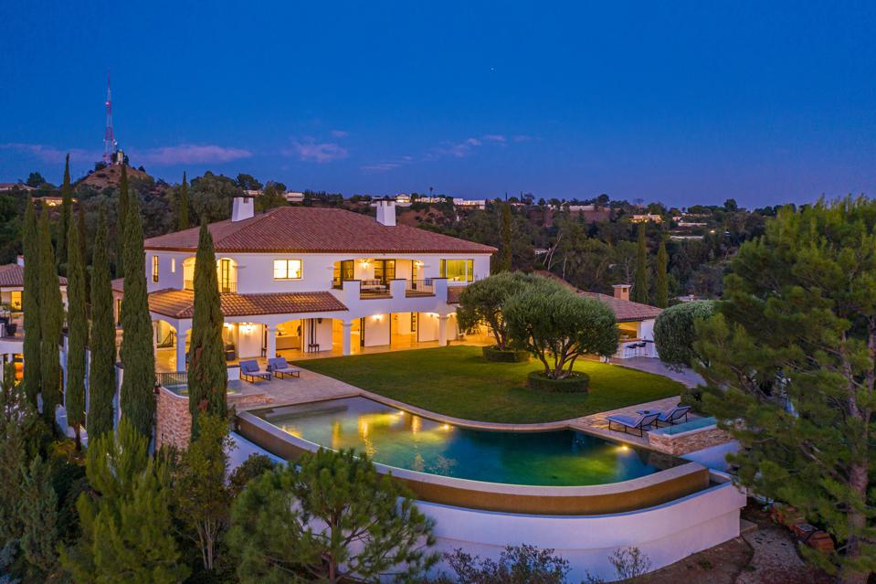 exterior house and pool at night at 2576 bowmont beverly hills california