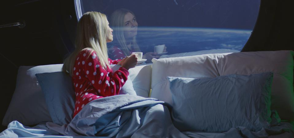 Woman enjoying view and coffee in a spaceship