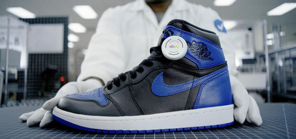 A collectible sneaker with an authenticity tag from eBay.