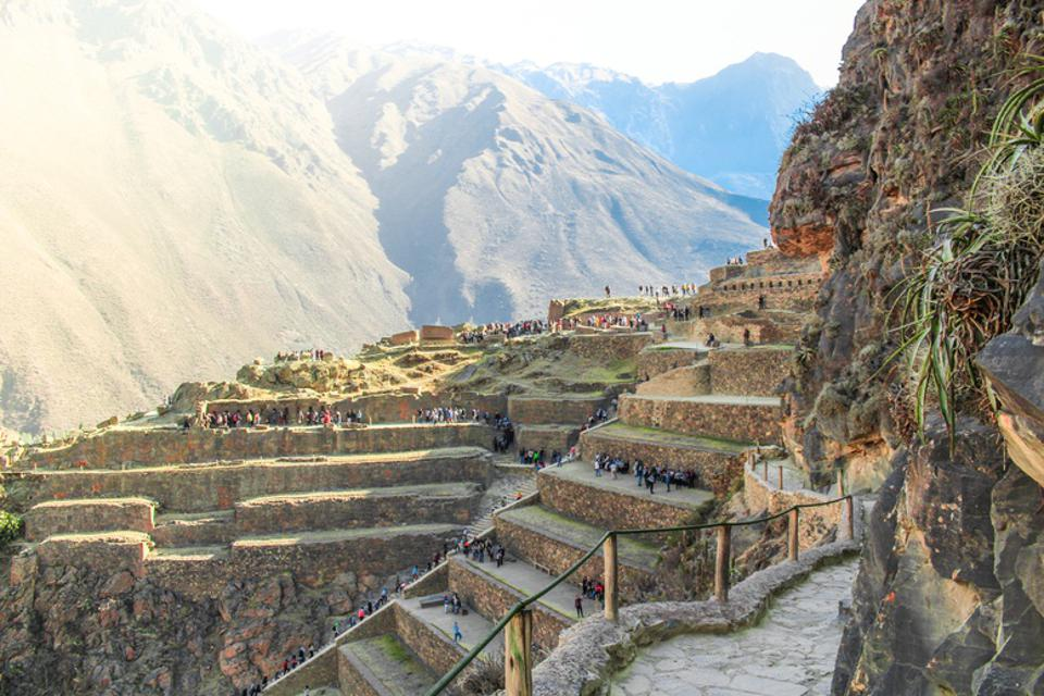 Stone terraces with tiny people walking on them.