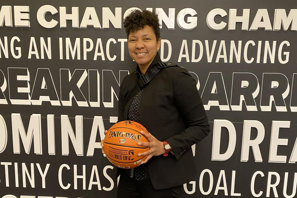 Ashland Johnson, founder of Inclusion Playbook, poses at partner NBA event