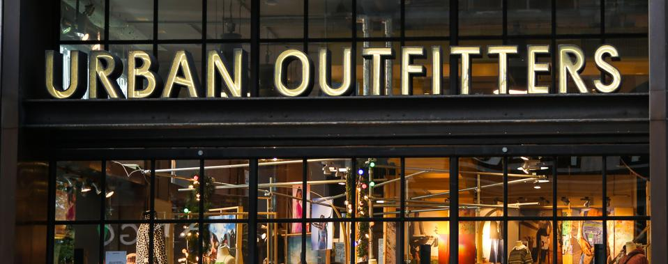 People walk past a branch of Urban Outfitters on Oxford...