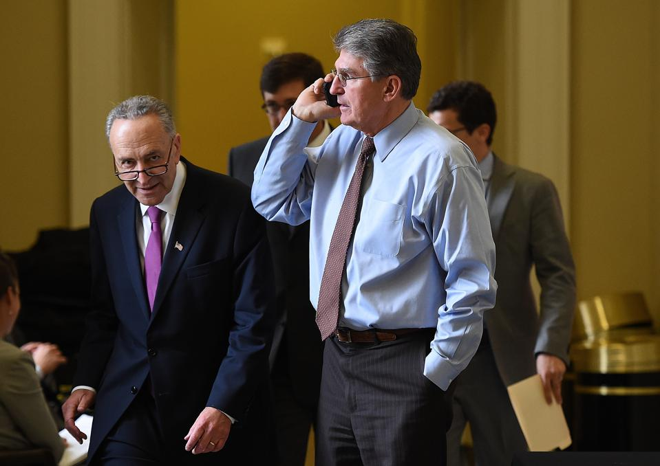 Sens. Chuck Schumer (D-NY) & Joe Manchin (D-WV). (Photo by Win McNamee/Getty Images)