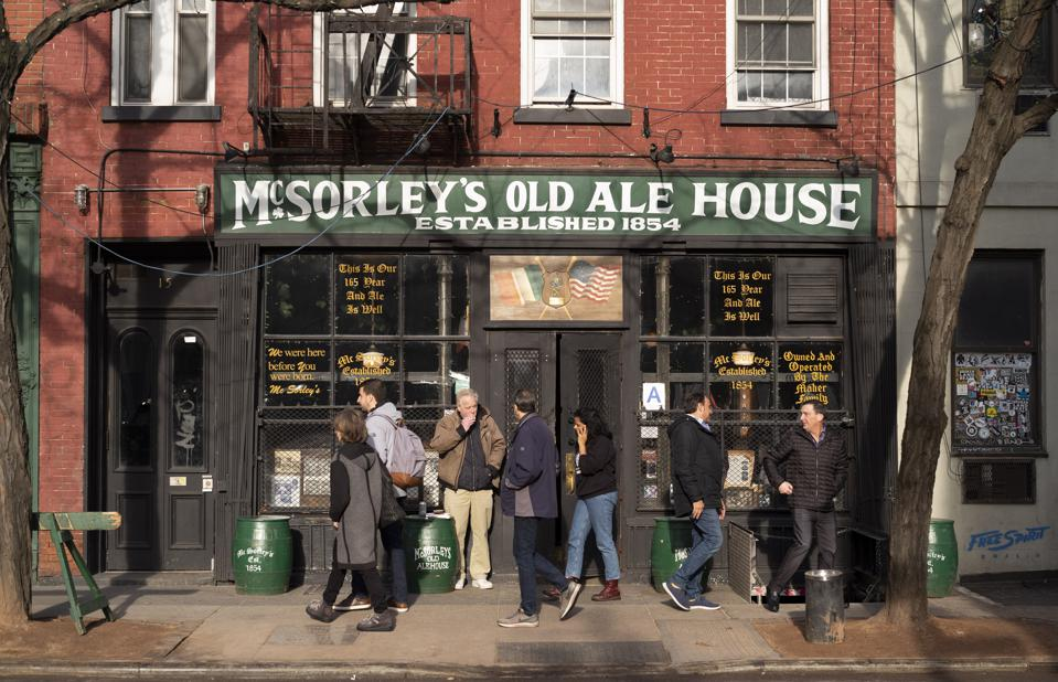McSorley's Old Ale House on Manhattan's Lower East Side opened In the mid-19th Century, was a speakeasy during Prohibition  and had plenty of customers in this December 2019 photo. (AP Photo/Mark Lennihan)