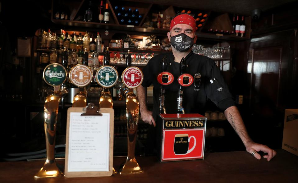 Ciaran Kavanagh stands behind John Kavanagh's bar, locally known as The Gravediggers, in Dublin, Ireland. (Photo by Brian Lawless/PA Images via Getty Images)