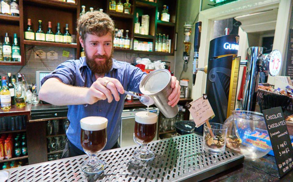 Prior to the pandemic, a bartender prepares Irish coffee at the Irish Whiskey Museum in Dublin, Ireland. (Photo by EyesWideOpen/Getty Images)