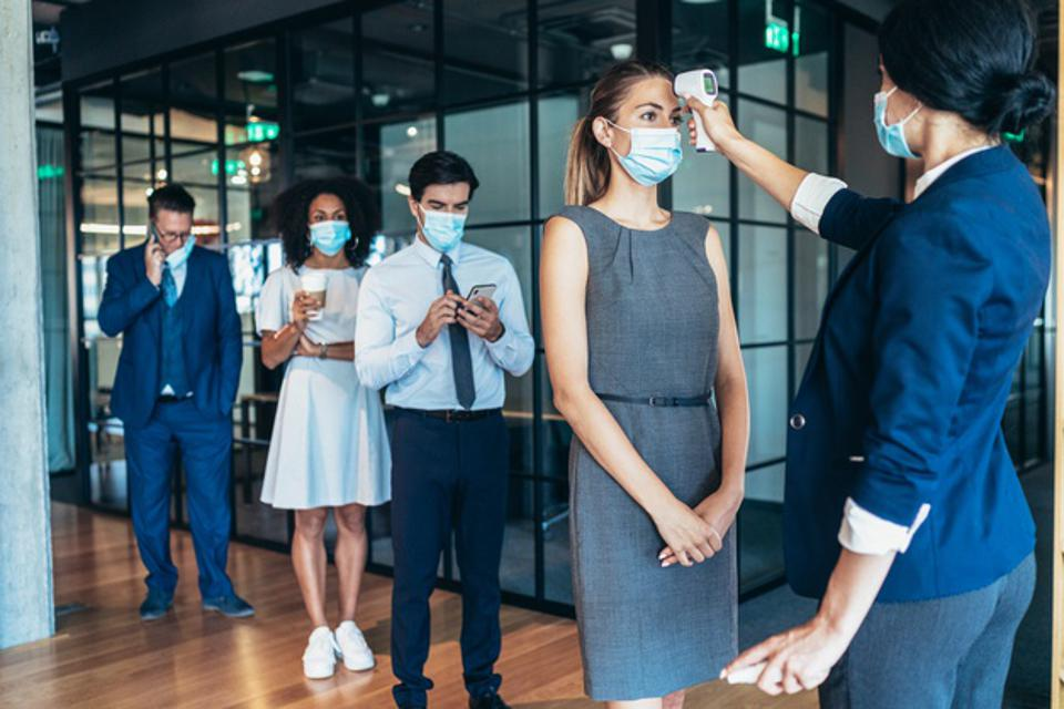 Business people measuring temperature in the office