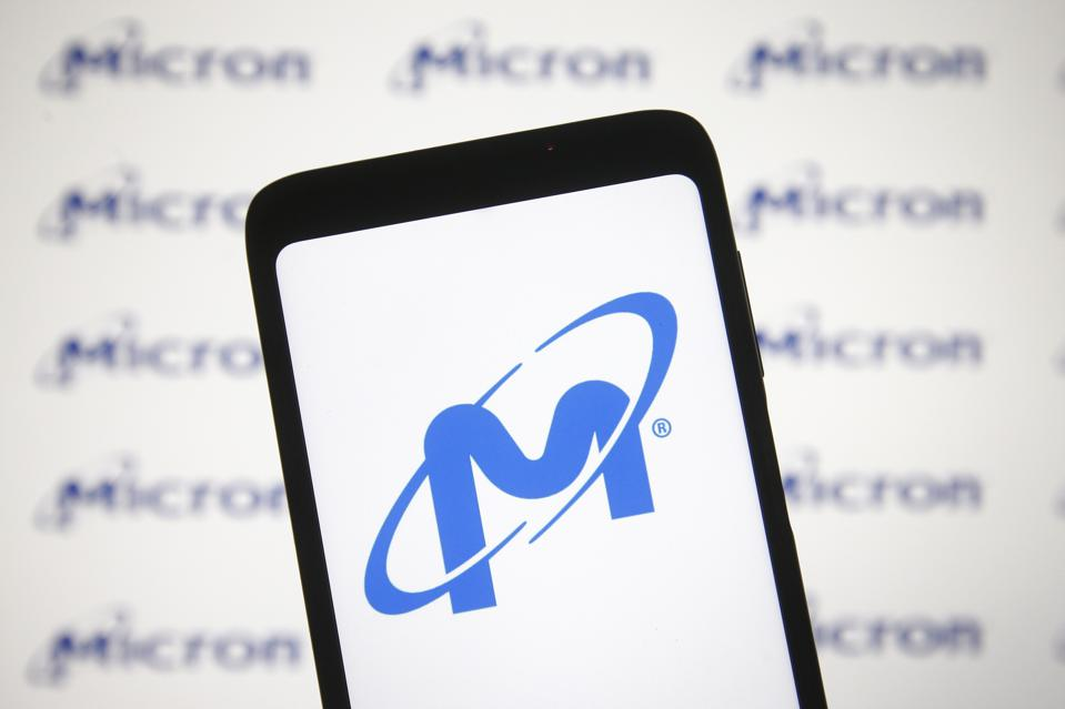 In this photo illustration a Micron logo is seen on a...