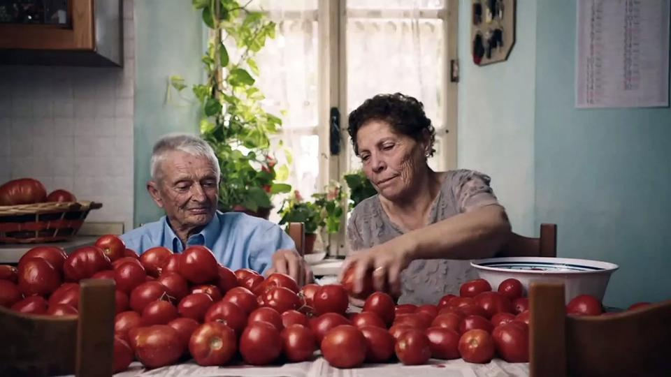 Carlo and his wife sorting tomatoes in The Truffle Hunters