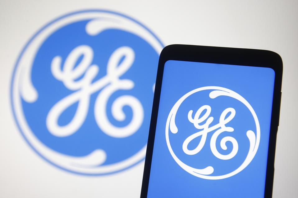 In this photo illustration a General Electric logo is seen...