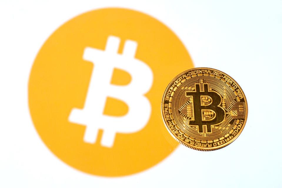 In this photo illustration, a Bitcoin is seen on a...
