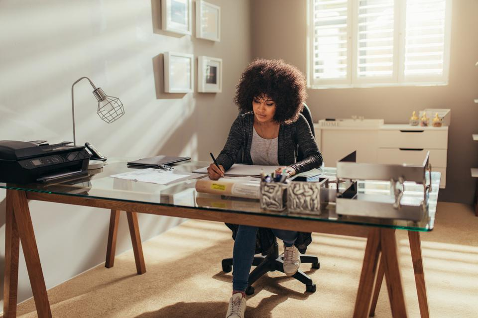 Female interior designer working at home office