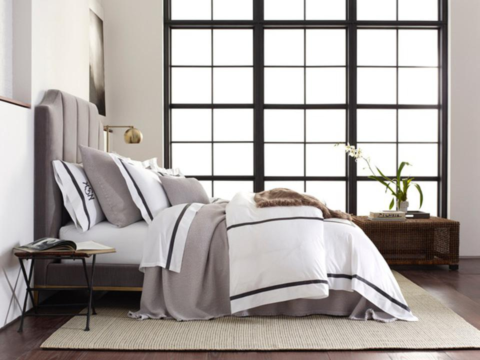 Bed with fine linens.