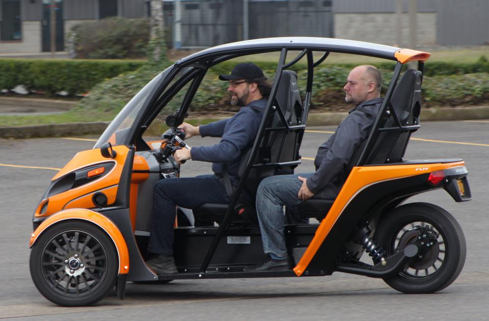Bill Roberson driving an Arcimoto FUV prototype.