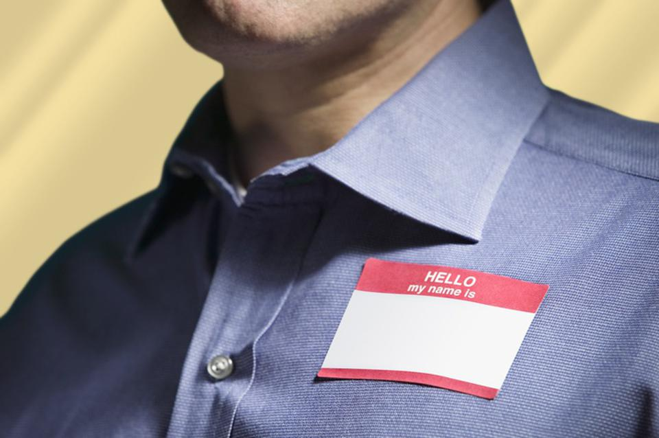Man Wearing ″Hello My Name Is″ Tag