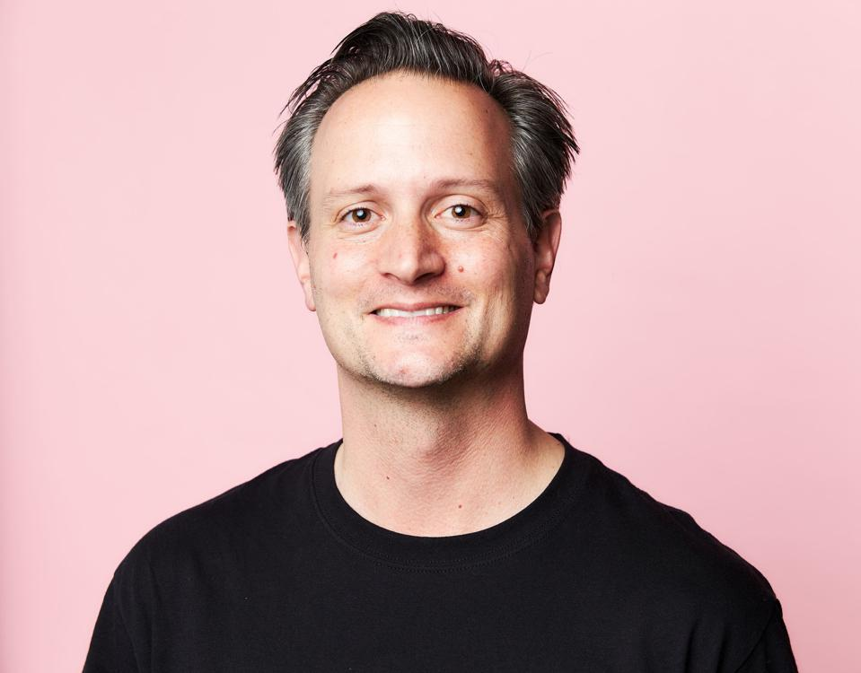 Headshot of James Citron the founder and CEO of pledge against a pink background.