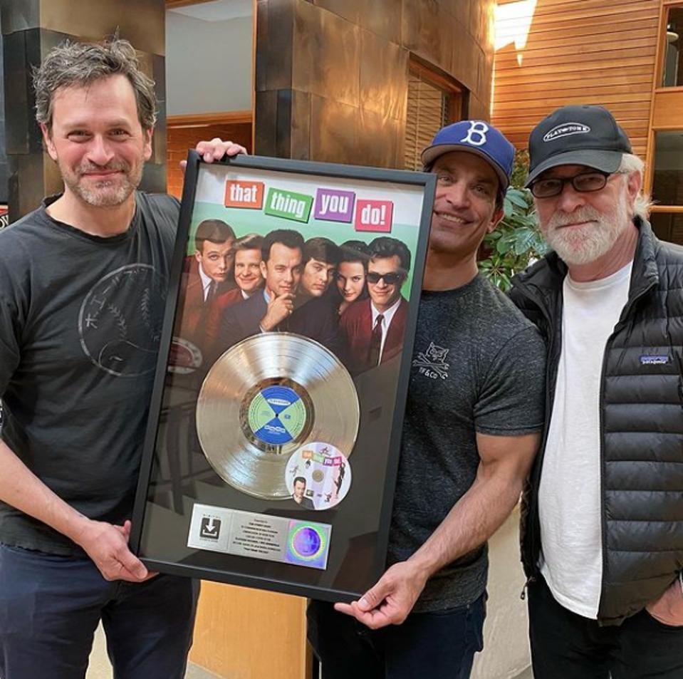 Tom Everett Scott, Johnathon Schaech and Gary Goetzman holding the That Thing You Do soundtrack's platinum record